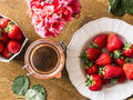 Strawberry jam and fresh strawberries bio flowers on the table Stock Photo