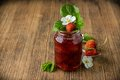 Strawberry jam in a glass jar with strawberries on Royalty Free Stock Photo