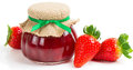 Strawberry jam in a jar and fresh berries Royalty Free Stock Photo