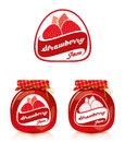 Strawberry jam label with jar of and designs for the Stock Photography