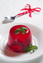 Strawberry jelly decorated with mint Royalty Free Stock Image