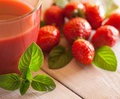 Strawberry juice glass of and strawberries in close up Royalty Free Stock Photography