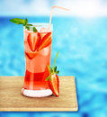 Strawberry juice on the poolside Royalty Free Stock Photo