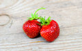 Strawberry juicy fresh ripe red strawberries on an old wooden textured table top Stock Images