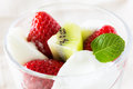 Strawberry and kiwi fruit in yogurt Royalty Free Stock Photos