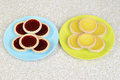 Strawberry and lemon tarts on plates Royalty Free Stock Photo