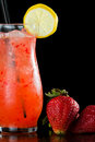 Strawberry lemonade isolated on a black background garnished with a lemon wheel Stock Image