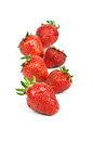Strawberry lies in one row isolated Royalty Free Stock Photos