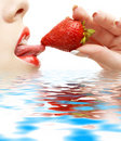 Strawberry, lips and tongue in Royalty Free Stock Photo