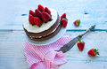 Strawberry mascarpone cake in front of white background against a a whole and Royalty Free Stock Photo