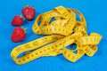 Strawberry with a measuring tape on karemat Royalty Free Stock Photo