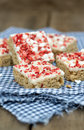 Strawberry and meringue topped flapjack on gingham cloth Royalty Free Stock Photography