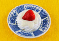 Strawberry meringue a with yogurt and a on a blue plate Stock Image