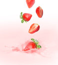 Strawberry milk or yogurt splash falling into splashing Stock Image
