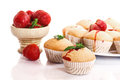 Strawberry muffins sweet with strawberries on a white background Stock Images
