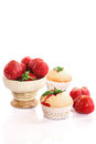 Strawberry muffins sweet with strawberries on a white background Royalty Free Stock Photos