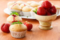 Strawberry muffins sweet with strawberries on wooden table Royalty Free Stock Image