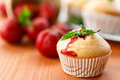 Strawberry muffins sweet with strawberries on wooden table Stock Photography