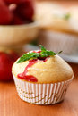 Strawberry muffins sweet with strawberries on wooden table Royalty Free Stock Photos