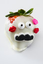 Strawberry with a mustache Royalty Free Stock Photo