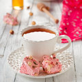 Strawberry nougat and cup of tea square image Royalty Free Stock Photo