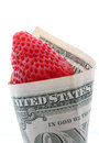 Strawberry in one dollar wrapped banknote Stock Photo