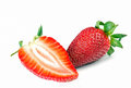 Strawberry with one slice on white background Royalty Free Stock Images