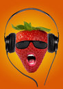 Strawberry open mouth sunglasses listening to music headphones Stock Photo