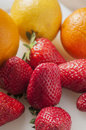 Strawberry and orange close up Royalty Free Stock Photos