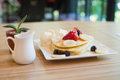 Strawberry pancake with syrup on woodentable Royalty Free Stock Photo