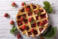 Strawberry pie in baking dish on the table horizontal top view Royalty Free Stock Photo