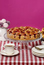 Strawberry pie on cake stand fuchsia background festive and party dessert Royalty Free Stock Photos