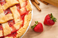 Strawberry pie homemade with strawberries and cinnamon on a wooden cutting board traditional late summer early fall dessert Royalty Free Stock Image