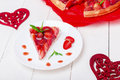 Strawberry pie on white plate and white wooden table. One piece.  Romantic. Love. Heart. Royalty Free Stock Photo