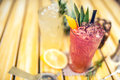 Strawberry pineapple alcoholic beverage, served cold with ice at bar. Cocktail drinks with lime, pineapple and alcohol as refr Royalty Free Stock Photo