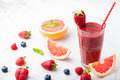 Strawberry, pink grapefruit smoothie, acai powder Royalty Free Stock Photo