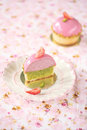 Strawberry pistachio mini tarts on pink background Stock Images
