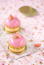 Strawberry pistachio mini tarts on transparent cutting board on pink background Royalty Free Stock Photo