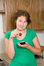 Strawberry portrait of attractive woman with in a kitchen Stock Images