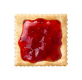 Strawberry preserves on a saltine cracker isolated white background Royalty Free Stock Photo