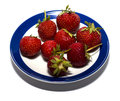 Strawberry on a round plate with a blue border Royalty Free Stock Photo