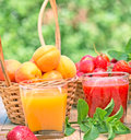 Strawberry smoothie and apricot juice Stock Images
