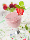 Strawberry smoothie with fresh berrie selective focus Stock Image
