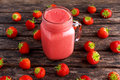 Strawberry smoothie in jar glass on wooden table. healthy food concept for breakfast or snack. Royalty Free Stock Photo