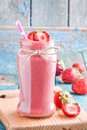 Strawberry smoothie in a jar with a straw Royalty Free Stock Photo