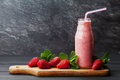 Strawberry smoothie or milkshake in jar on black rustic background, healthy food for breakfast Royalty Free Stock Photo