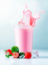 Strawberry smoothie splash Stock Images