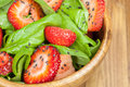 Strawberry spinach salad with poppy seed and sesame dressing close up Royalty Free Stock Images