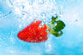Strawberry splash in water- top view Royalty Free Stock Photo