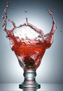 Strawberry splashing in glass with juice Royalty Free Stock Images